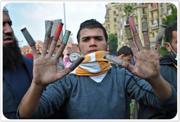 Each finger shows off a shotgun shell used on protesters over the course of the clashes in and around Tahrir Square. November 2011. Photo: Ali Mustafa